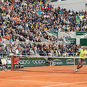 PARIS, FRANCE June 07.  Rafael Nadal of Spain and Roger Federer of Switzerland exchange shots at the net during their match on Court Philippe-Chatrier during the Men's Singles Semifinals match at the 2019 French Open Tennis Tournament at Roland Garros on June 7th 2019 in Paris, France. (Photo by Tim Clayton/Corbis via Getty Images)