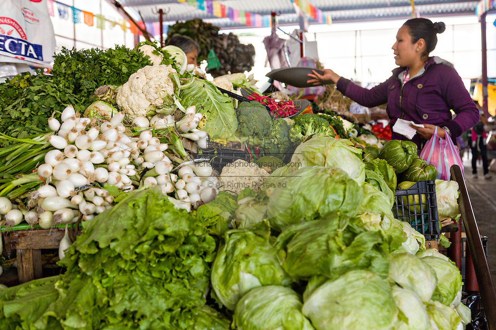 A fresh vegetable stand at the Sunday market in Tlacolula de Matamoros, Mexico. The regional street market draws thousands of sellers and shoppers from throughout the Valles Centrales de Oaxaca.