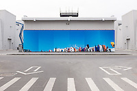 DUBAI, UAE - APRIL 30, 2016: A temporary installation printed on a PVC banner by artist Mohammed Kazem welcomes visitors at Alserkal Avenue in Dubai' Al Quoz Industrial Area.