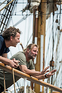 SCHEVENINGEN, NETHERLANDS, 16 JUNE 2020.  Captain Eric Kesteloo (r) and cook Gjalt Gaastra (l). Dutch Historical tall ship Bark Europa arrives in the home port of Scheveningen after an 82 days non-stop sailing expedition. Being denied accesss in Ushuaia, Argentina and most other ports due to Covid-19 quarantine and with no place to go, the ship had to sail back the 10.000 miles to The Netherlands. With no ports to resupply and just powered by the wind, this epic journey has never been done before.  © Photo by Frits Meyst  /  WideOyster.com for Bark Europa.