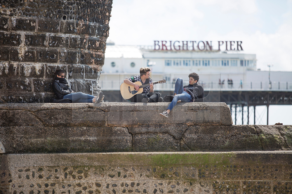 © Licensed to London News Pictures. 20/05/2017. Brighton, UK. Members of the public take advantage of the sunny weather to spent some time on the beach in Brighton and Hove. Photo credit: Hugo Michiels/LNP