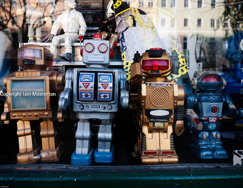 Detail of toy robots in window of trendy fashion boutique in bohemian Prenzlauer Berg district of Berlin Germany