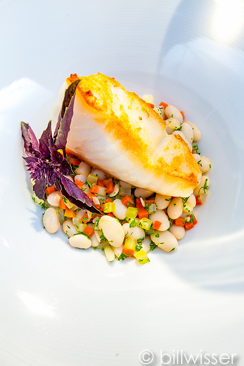 Parmesan-crusted seabass with white beans