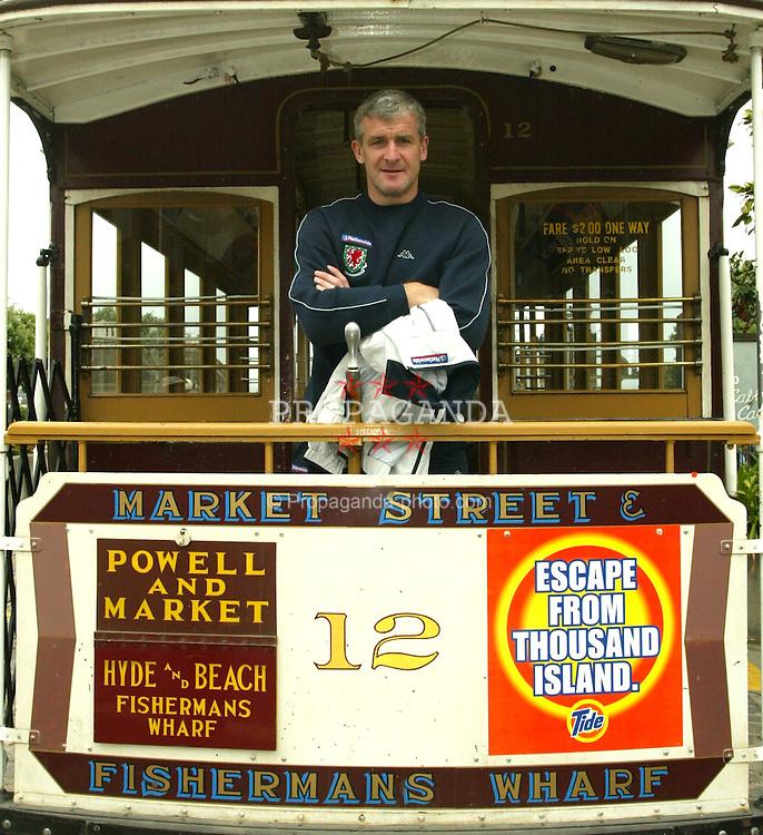 SAN FRANCISCO, USA - Sunday, May 25, 2003: Wales' manager Mark Hughes pictured on a San Francisco cable car or 'trolly' at Fisherman's Wharf, San Francisco. (Pic by David Rawcliffe/Propaganda)