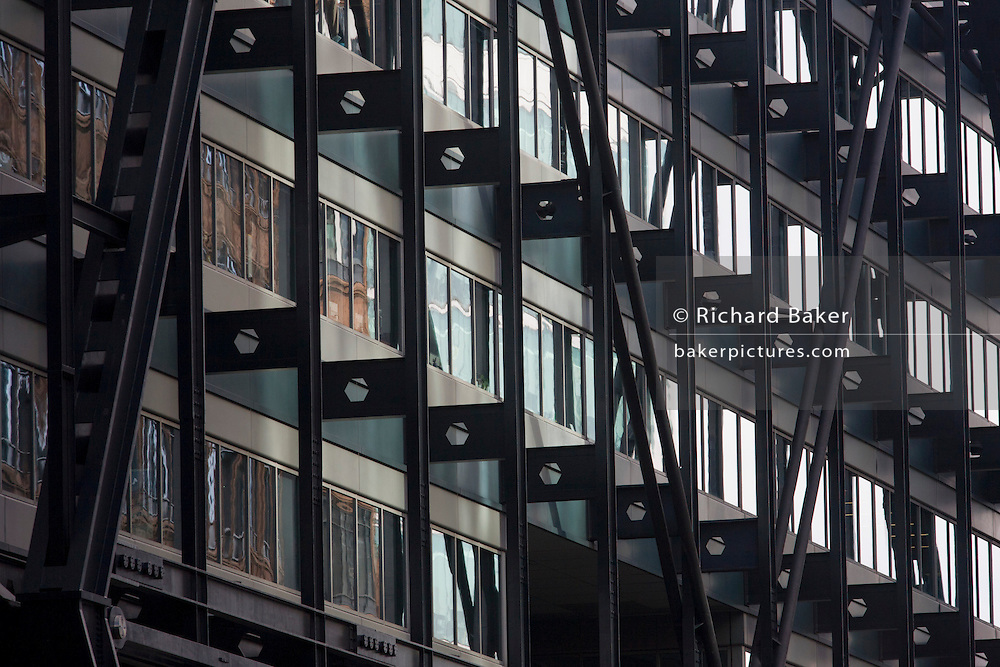 Corporate offices perspective in the City of London. Seen from a distance, away from this location on the northern boundary of the old part of London, we see the steel structure built in the 1980s at the height of Thatcher's building boom, the Broadgate development within the ancient boundary of the capital's Square Mile, it's financial district founded by the Romans in AD43.