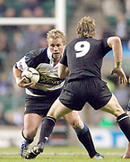 2004_'The Gartmore Challenge' - Barbarians_vs_New-Zealand..Baabaa's scrum scrum half Justin Marshall looks to go around his  All Black counter part Jimmy Cowan.. .04.12.2004 Photo  Peter Spurrier. .email images@intersport-images.com...
