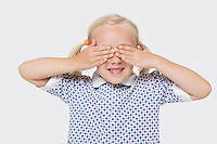 Young girl covering her eyes over white background