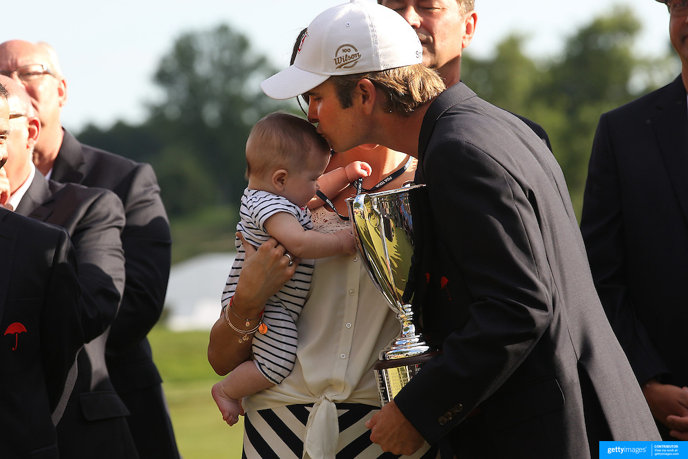 Kevin Streelman kisses his 6-month-old daughter Sophia, watched by his wife Courtney after winning the Travelers Championship at the TPC River Highlands, Cromwell, Connecticut, USA. 22nd June 2014. Photo Tim Clayton