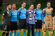 Melbourne City defender Scott Jamieson (3) and Newcastle Jets defender Nigel Boogaard (4) pose with officials before the FFA Cup Round 16 soccer match between Melbourne City FC v Newcastle Jets at AAMI Park in Melbourne.