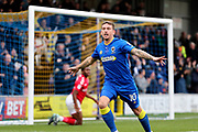 AFC Wimbledon striker Cody McDonald (10) celebrating after scoring goal to make it 1-0 during the The FA Cup match between AFC Wimbledon and Charlton Athletic at the Cherry Red Records Stadium, Kingston, England on 3 December 2017. Photo by Matthew Redman.
