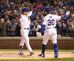 October 18, 2017 - Chicago, IL, USA - The Chicago Cubs' Javier Baez celebrates his solo home run in the second inning with teammate Jon Jay (30) against the Los Angeles Dodgers during Game 4 of the National League Championship Series at Wrigley Field in Chicago on Wednesday, Oct. 18, 2017. (Credit Image: © Brian Cassella/TNS via ZUMA Wire)