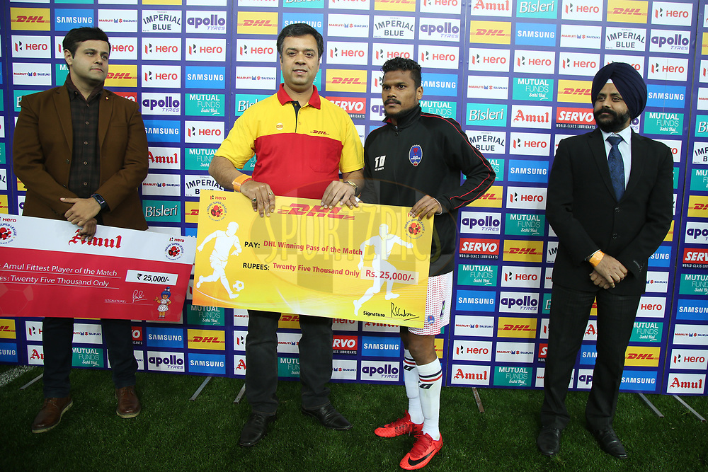 Romeo Fernandes of Delhi Dynamos FC receive winning pass of the match award during match 43 of the Hero Indian Super League between Delhi Dynamos FC and Kerala Blasters FC  held at the Jawaharlal Nehru Stadium, Delhi, India on the 10th January 2018<br /> <br /> Photo by: Deepak Malik  / ISL / SPORTZPICS