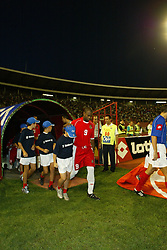 BELGRADE, SERBIA & MONTENEGRO - Wednesday, August 20, 2003: Wales' Nathan Blake walks out to face Serbia & Montenegro before the UEFA European Championship qualifying match at the Red Star Stadium. (Pic by David Rawcliffe/Propaganda)