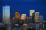 SHOT 8/30/2007 - Images of the skyline of downtown Denver, Co. at dusk including Union Station in the foreground. Denver is the capital and the most populous city of Colorado. Denver is located in the South Platte River Valley on the High Plains just east of the Front Range of the Southern Rocky Mountains. The Denver downtown district is located immediately east of the confluence of Cherry Creek with the South Platte River, approximately 15 miles east of the foothills of the Rocky Mountains. Denver is nicknamed The Mile-High City because its official elevation is exactly one mile (5,280 feet or approximately 1,609 meters) above sea level. The United States Census Bureau estimates that, in 2006, the population of the City and County of Denver was 566,974, making it the 27th most populous U.S. city..(Photo by Marc Piscotty © 2007)