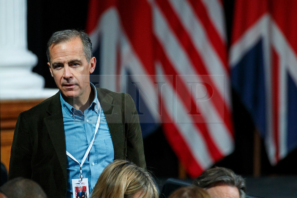 © Licensed to London News Pictures. 23/04/2016. London, UK. Governor of the Bank of England MARK CARNEY listening President of the United States Barack Obama holding a Q&A session with young people at Lindley Hall, Royal Horticultural Society in central London on Saturday, 23 April 2016. Photo credit: Tolga Akmen/LNP