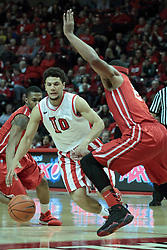 15 February 2014:  Kaza Keane dribbles his way in and meets Tyshon Pickett during an NCAA Missouri Valley Conference (MVC) mens basketball game between the Bradley Braves and the Illinois State Redbirds  in Redbird Arena, Normal IL.