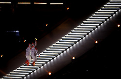 The final torch bearers make their way up to the Olympic Cauldron to light the flame during the opening ceremony of the PyeongChang 2018 Winter Paralympics at the PyeongChang Olympic Stadium in South Korea.