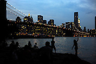 Brooklyn, NY: Saturday, July 24, 2010-- People gather in Brooklyn Bridge Park to watch the sunset and New York City skyline at night.  © Audrey C. Tiernan