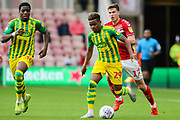 West Bromwich Albion midfielder Grady Diangana (29) chased by Middlesbrough midfielder Paddy McNair (17) during the EFL Sky Bet Championship match between Middlesbrough and West Bromwich Albion at the Riverside Stadium, Middlesbrough, England on 19 October 2019.