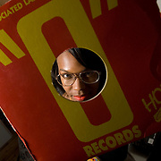 "DJ Lindsey Caldwell, who goes by ""DJ Lindsey,"" is photographed with her turntables and part of her vinyl record collection at her home in Brooklyn on Nov. 21, 2007."