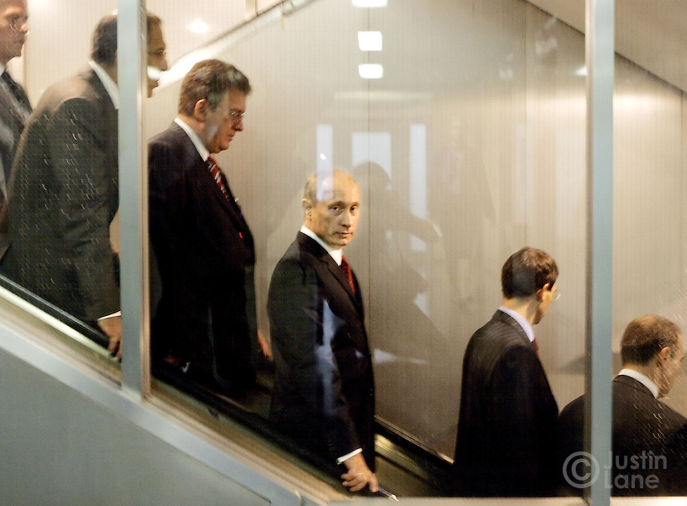 Russian President Vladimir Putin (C) is seen on an escalator between meetings during the second day of the 2005 World Summit of the United Nations at UN headquarters in New York City, Thursday 15 September 2005.