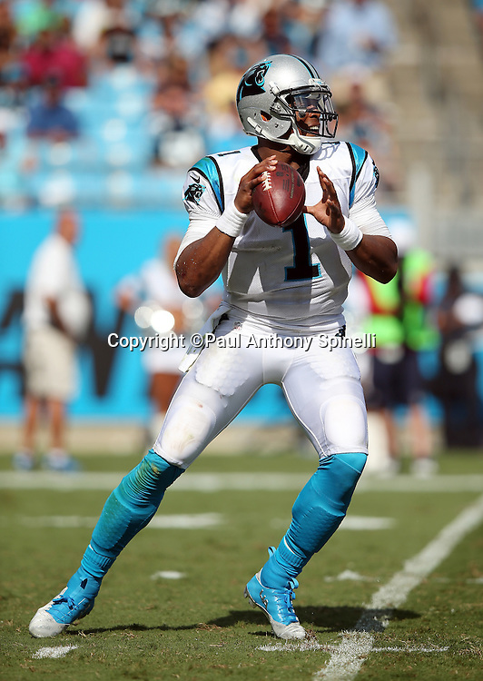 Carolina Panthers quarterback Cam Newton (1) drops back to pass during the 2015 NFL week 2 regular season football game against the Houston Texans on Sunday, Sept. 20, 2015 in Charlotte, N.C. The Panthers won the game 24-17. (©Paul Anthony Spinelli)