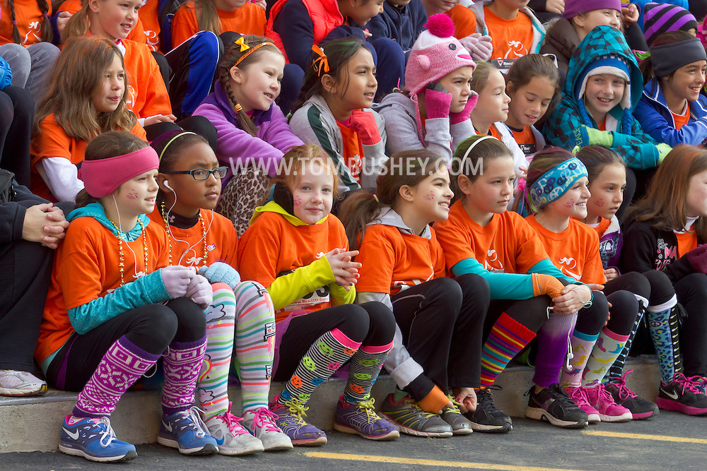 Cornwall-on-Hudson, New York - Girls in the Girls on the Run Hudson Valley program line up for a group photograph before racing 3.1 miles at the Cornwall Lions Club Fall Harvest Race 5K on Nov. 10, 2013. Girls on the Run is a national program with a mission of helping girls to be joyful, healthy and confident using an experience-based curriculum which creatively integrates running.