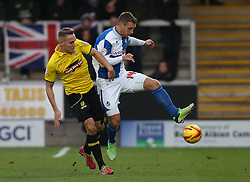 Bristol Rovers' Lee Brown battles with Burton Albion's Chris Hussey- Photo mandatory by-line: Matt Bunn/JMP - Tel: Mobile: 07966 386802 23/11/2013 - SPORT - Football - Burton - Pirelli Stadium - Burton Albion v Bristol Rovers - Sky Bet League Two
