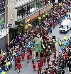 """20.04.2012, Liverpool, England, GBR, Sea Odyssey, a Giant Spectacular, im Bild das kleine Riesen Maedchen, eine 9 meter hohe marionette, spaziert von Zuschauern umringt durch das Shopping Center Liverpool ONE. Das weltweit größte Straßentheater """"Sea Odyssey, a Giant Spectacular"""" der Straßentheatergruppe Royal de Luxe aus Frankreich und ist Teil einer Reihe von Veranstaltungen anlässlich des 100. Jahrestages des Untergangs der Titanic. Sea Odyssey ist eine magische Geschichte über Liebe, Verlust und Wiedersehen auf einem gigantischen Maßstab gespielt und begeistert in den Strassen von Liverpool Hunderttausende Zuschauer // The Little Girl Giant, a 30ft tall marionette, walks through Liverpool ONE shopping area in Liverpool in north-west England. The girl is part of a street theatre production entitled Sea Odyssey - a Giant Spectacular. Two marionettes controlled by lilliputians, a driver and a girl, his niece, will roam through the city's streets looking for each other during the three day production. The free event, organised by French company Royal de Luxe is one of a series of events marking the 100th anniversary of the sinking of the Titanic. EXPA Pictures © 2012, PhotoCredit: EXPA/ Propagandaphoto/ Vegard Grott..***** ATTENTION - OUT OF ENG, GBR, UK *****"""