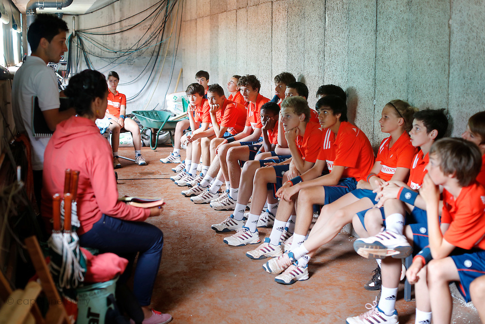 Roland Garros. Paris, France. June 1st 2012.A day with the ball boys..Team briefing with coaches under the Suzanne Lenglen Court