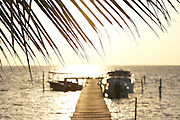 Belize, Central America - Sunrise and one of the many private, wooden piers on the Caye Caulker waterfront.