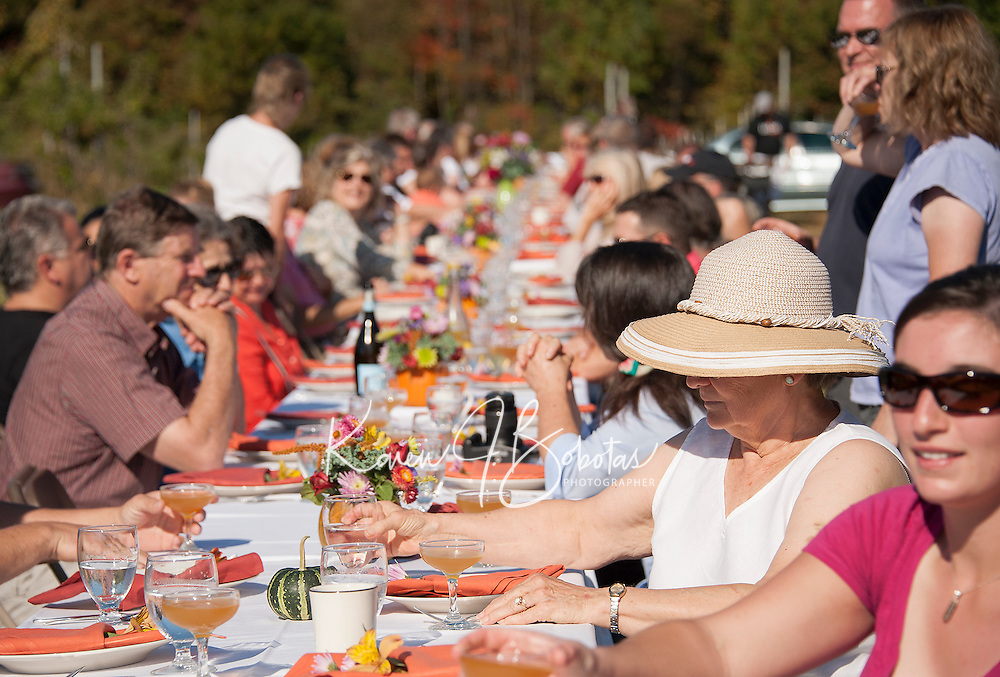 """Just under 100 guests sit down together to enjoy Local Eatery's """"Breakfast in the Orchard"""" held Sunday morning at Smith's Orchard in Belmont.  (Karen Bobotas/for the Laconia Daily Sun)"""