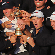 Ryder Cup 2016. Day Three. The United States team with the Ryder Cup as Jordan Spieth and Patrick Reed celebrate after the United States victory in the Ryder Cup tournament at Hazeltine National Golf Club on October 02, 2016 in Chaska, Minnesota.  (Photo by Tim Clayton/Corbis via Getty Images)