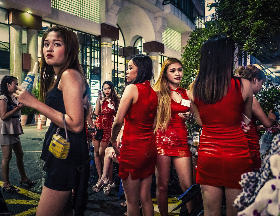 Girls waiting for clients in Soi Thaniya also known as little Tokyo in the Patpong area one of the most famous red light districts in Bangkok Thailand. This red light area is most visited by Japanese man. Many bars and karaoke in the upper floors are catered for japanese males visiting or living in Bangkok.