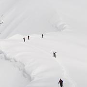 Skiers ascending mt. Lambárhnjúkur 1027m. Hvalvatnsfjörður, Iceland.