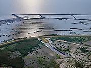 Nederland, Flevoland, Markermeer, 26-08-2019; Marker Wadden in het Markermeer. Westelijk deel archipel met tegenlicht, gezien  naar het westen. Doel van het project van Natuurmonumenten en Rijkswaterstaat is natuurherstel, met name verbetering van de ecologie in het gebied, in het bijzonder de kwaliteit van bodem en water<br /> Naast het hoofdeiland is er inmiddels een tweede eiland in wording, de uiteindelijk Marker Wadden archipel zal uit vijf eilanden bestaan. <br /> Marker Wadden, artifial islands. The aim of the project is to restore the ecology in the area, in particular the quality of soil and water.<br /> The first phase of the construction, the main island, is finished. <br /> <br /> luchtfoto (toeslag op standard tarieven);<br /> aerial photo (additional fee required);<br /> copyright foto/photo Siebe Swart
