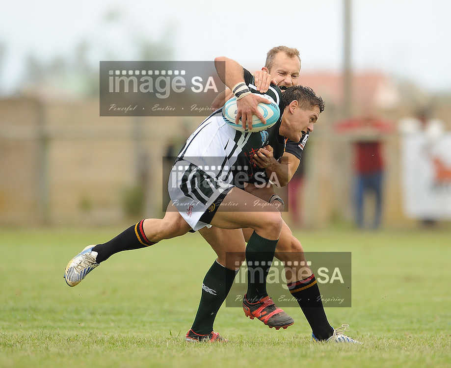 GEORGE, SOUTH AFRICA - Saturday 7 March 2015, Johannes Lambrechts of Pacaltsdorp Evergreens is tackled by Kyle Dutton of Vaseline Wanderers during the third round match of the Cell C Community Cup between Pacaltsdorp Evergreens and Vaseline Wanderers at Pacaltsdorp Sports Grounds, George<br /> Photo by Roger Sedres/ImageSA/ SARU