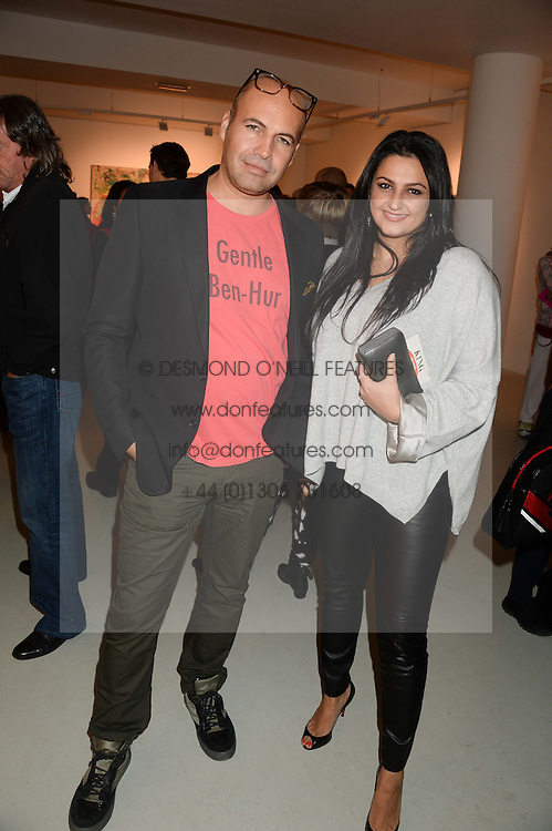 BILLY ZANE and KIRAN SHARMA the manager of singer Prince at a private view of an exhibition of paintings by Billy Zane entitled 'Save The Day Bed' held at the Rook & Raven Gallery, Rathbone Place, London on 10th October 2013.