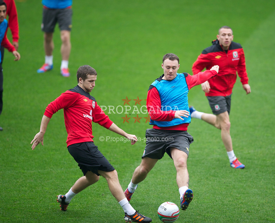 CARDIFF, WALES - Monday, February 27, 2012: Wales' Adam Matthews and Darcy Blake during a training session at the Cardiff City Stadium ahead of the friendly match against Costa Rica. (Pic by David Rawcliffe/Propaganda)