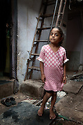 Young Girl and Ladder - Dharavi, Mumbai, India