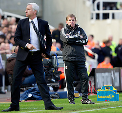 NEWCASTLE-UPON-TYNE, ENGLAND - Sunday, April 1, 2012: Liverpool's manager Kenny Dalglish and Newcastle United's manager Alan Pardew during the Premiership match at St James' Park. (Pic by Vegard Grott/Propaganda)