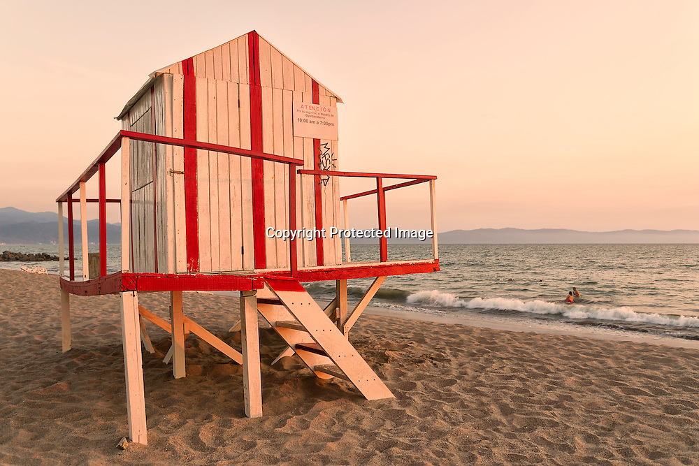 Lifeguard Hut on a Nuevo Vallarta's beach in Mexico with couple enjoying the waves in the background.