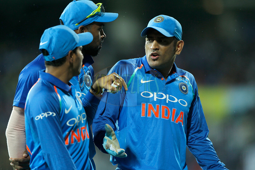 Mahendra Singh Dhoni of India talk with Hardik Pandya and Kuldeep Yadav of India during the 1st One Day International between India and Australia held at the M. A. Chidambaram Stadium in Chennai on the 17th September 2017<br /> <br /> Photo by Deepak Malik / BCCI / SPORTZPICS