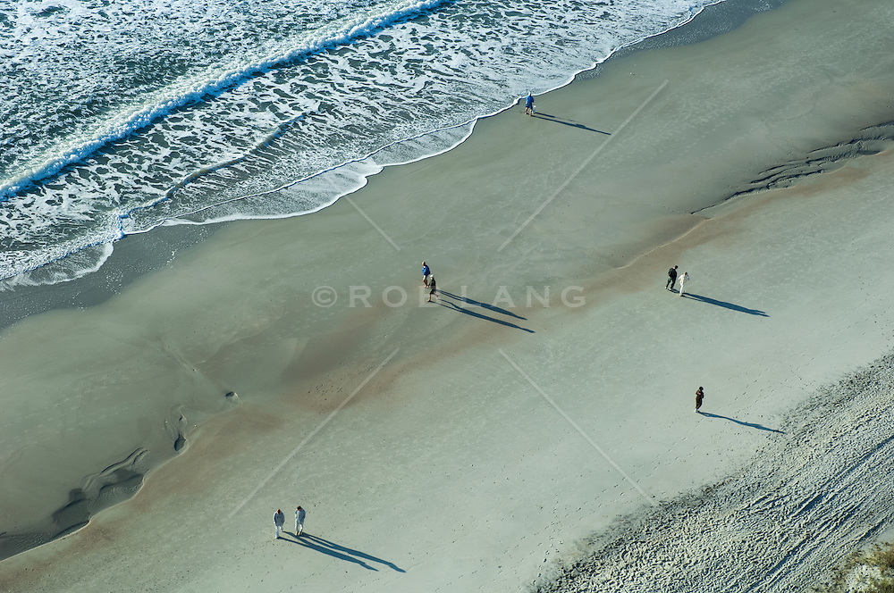 Myrtle Beach, South Carolina with shore line and a few people at sunrise photographed from above