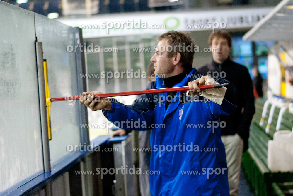 Simon Jaksic cleaning windows before ice hockey friendly match between team Slovenia and Croatia before World Championship 2012 Division I Group A, on April 7, 2012 at Hala Tivoli, Ljubljana, Slovenia. (Photo By Matic Klansek Velej / Sportida.com)