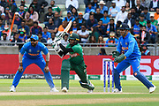 Shakib Al Hasan (vc) of Bangladesh plays an attacking shot during the ICC Cricket World Cup 2019 match between Bangladesh and India at Edgbaston, Birmingham, United Kingdom on 2 July 2019.