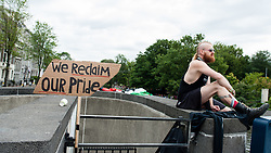 August 5, 2017 - Amsterdam, Netherland - On August 5th, 2017. Before and during the celebration of The Canal Parade in Amsterdam, an action called ''We Reclaim our Pride'', took place in one of the bridges of Amsterdam. The reason of this action is, that the Pride has become a celebration that involves the participation of certain corporations and political parties that are far removed from this fight for freedom. This action is oranizated by several groups that cannot celebrate the freedom of one group at the expense of the freedom of other groups. Although the LGBTQI+ movement has made significant progress since the Stonewall riots, there is still a lot to gain when it comes to the liberation from hetero/cis-normativity and sexism in the Netherlands. (Credit Image: © Romy Arroyo Fernandez/NurPhoto via ZUMA Press)