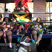 Tired dancers on a truck after two days of carnival. The Notting Hill Carnival has been running since 1966 and is every year attended by up to a million people. The carnival is a mix of amazing dance parades and street parties with a distinct Caribbean feel.