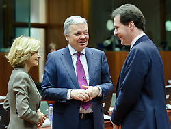George Osborne, the UK's chancellor of the exchequer,  right, speaks with Elena Salgado, Spain's finance minister, left, and Didier Reynders, Belgium's finance minister, during a meeting of EU finance ministers, at the European Council headquarters, in Brussels, Tuesday, Dec. 7, 2010. (Photo © Jock Fistick).