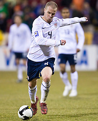 United States midfielder Michael Bradley (4) strikes the ball for the second goal of the game in the 92nd minute.  The United States men's soccer team defeated the Mexican national team 2-0 in CONCACAF final group qualifying for the 2010 World Cup at Columbus Crew Stadium in Columbus, Ohio on February 11, 2009.